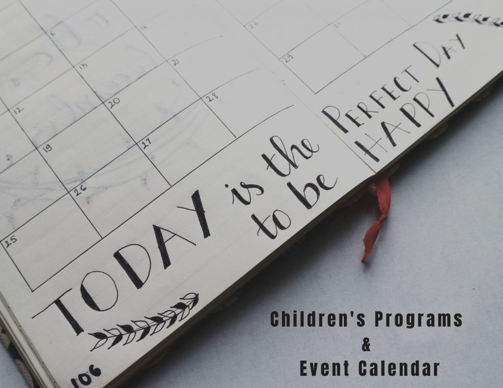 Image description: on a white table a blank planner is open to a month calendar page. Handwritten text reads 'Today is the perfect day to be happy'. In the lower right corner, bold font reads 'children's programs and event calendar'