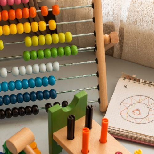 Image of a rainbow abacus and wooden child's toy