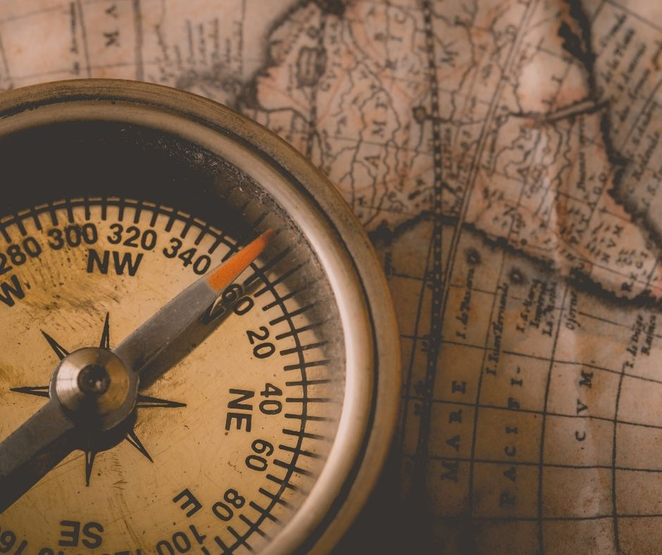 Image of a compass on a map