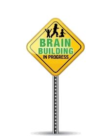 Image of a yellow diamond sign with an outline of three people one very small, one jumping and one kneeling. text reads brain building in progress.