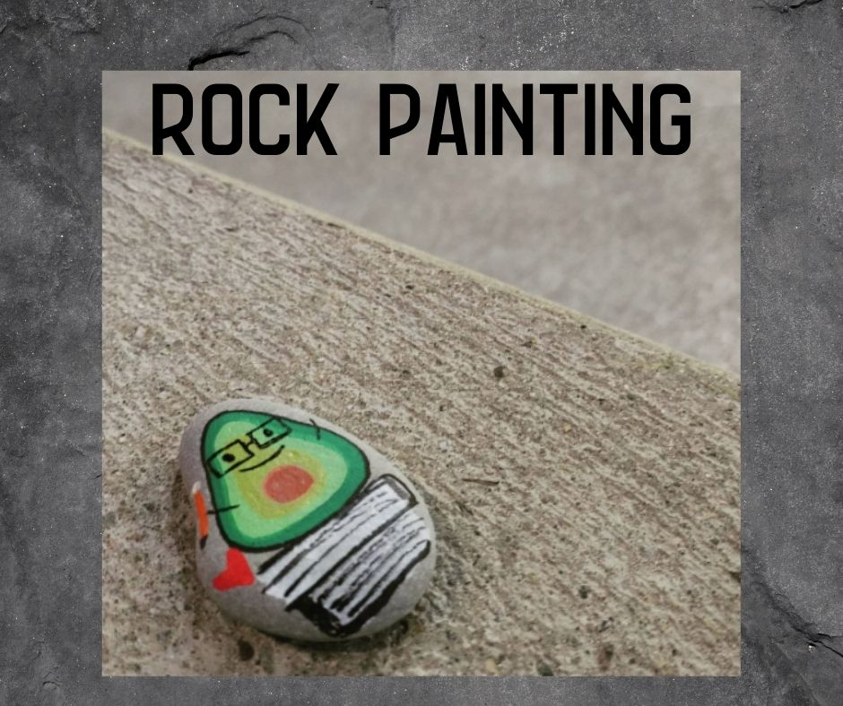 Image of a happy little avocado painted on a rock text reads 'rock painting'